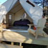 Platform tent under the pines