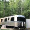 Mountain creekside Avion Camper