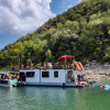Houseboat In A Lake Travis Cove