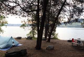 """Site A21 is one of the largest (non-electric) sites you'll find anywhere.  It's right on the Flathead Lake, with westward views to incredible sunsets and an """"AWWWW!""""-inspiring panorama."""