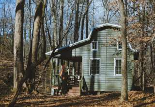 An exterior shot of the cabin on a sunny morning.