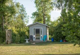 This beautiful tiny cabin rests on a large property but nestled on the edge so the views from the bed are direct to the pond and spectacular!