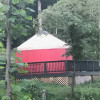 Red yurt in beautiful setting