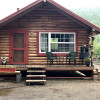 R and M Rustic River Log Cabin