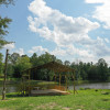 Tent camping by seven acre pond