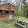 Guthrie Meadows green door cabin