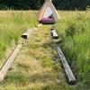 tee-pee amongst the tall grasses
