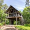 House on stilts on a green edge