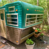 Vintage Camper in Forest by Parkway