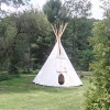 tipi by the stream