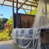 Mango tree cabin above stream